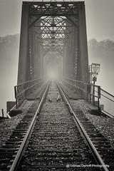 Rail Road Bridge in the fog Dubuque Iowa (Thomas DeHoff) Tags: railroad bridge bw fog sony iowa dubuque a700
