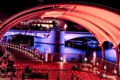 The Riverwalk at night (pandt) Tags: bridge people music skyline architecture night canon river tampa eos lights photo flickr nightscape bright florida sidewalk entertainer dslr riverwalk streetentertainer hillsboroughriver t1i