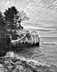 Winter Beauty (mswan777) Tags: winter sky bw lake seascape cold ice beach apple nature water clouds rocks waves michigan shoreline scenic breakwall iphone iphoneography