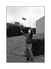 spinning at full speed (Istvan Penzes) Tags: street family portrait bw white black dof play thomas availablelight handheld 6x9 rodinal manualfocus kodaktmax400 diabolo wideopen homedeveloped polaroid600se aphog penzes mamiya127mm47 imaconflextight343