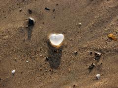 Heart on the beach (Elizabeth Purdon) Tags: shadow beach glass seaside sand shadows heart crystal pebbles crystalheart glassheart