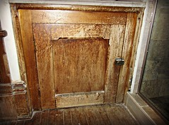 White Rabbit's Door?? (AmyEAnderson) Tags: door wood bathroom wooden inn floor cabinet antique room secret victorian iowa historic worn aged bb knob scratched dubuque latch