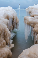 Crack of Dawn (Aaron Springer) Tags: winter lighthouse ice nature landscape dawn outdoor michigan lakemichigan february icicles frankfort northernmichigan iceshelf thegreatlakes frankfortlighthouse betsieriverchannel