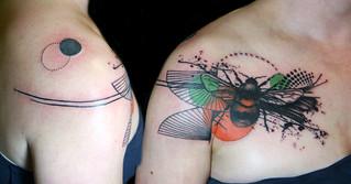 graphic bee tattoo