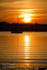 IMG_9869 (Churruk) Tags: sol contraluz atardecer andaluca agua barco huelva sombra playa movimiento cielo reflejo ayamonte islacanela