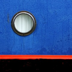 Port hole (Andrea Kennard) Tags: blue windows light red abstract lines yellow metal buildings square colours business shade colourful residential