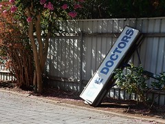 Dodgy Doctors (mikecogh) Tags: sign fallen ironic eyedoctor woodville