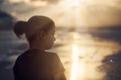 (Rebecca812) Tags: portrait sun reflection beach nature water girl beauty childhood sunrise canon child pensive rays enjoyment rebecca812