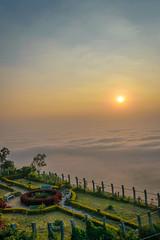 Glowing rays, warm matte clouds. (arssantosh) Tags: sunrise colorful bangalore foggy nandihills warmtones sunrisecolors