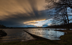 April weather (jarnasen) Tags: trees sunset sky copyright sunlight lake storm reed nature weather clouds evening wooden spring nikon cloudy sweden outdoor jetty tripod wide lakeside changing april sverige nikkor stergtland d810 nordiclandscape 1635mmf4 jarnasen