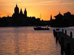 Amsterdam Oosterdok Sunset (joiseyshowaa) Tags: travel cruise sunset sun water amsterdam bike sunrise dawn harbor dusk library rise centrum barge mosi oosterdok bibliotech