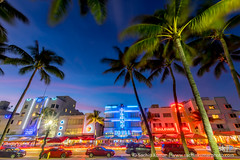 Art Deco District (skumar0108) Tags: travel blue trees party art cars beach restaurant sand florida miami dusk district wideangle palm palmtrees artdeco fl bluehour breeze deco southbeach thebluehour distrotion afterdusk trailinglights cartraillights