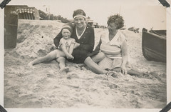 Two women and child at the beach (simpleinsomnia) Tags: old family woman white black beach girl monochrome smiling vintage naked found blackwhite kid sand europe child little antique snapshot photograph littlegirl vernacular foundphotograph descalas filosofianatural descalcinho