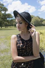 Celeste (Julieta Weller.) Tags: life portrait people woman sun black sol hat fashion relax fun model dress outdoor country calm sombrero