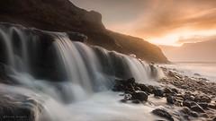 Torrent (Sarah_Brooks) Tags: longexposure morning sea seascape water rain sunrise waterfall falls le rush dorset milky goldenhour downpour torrent deluge