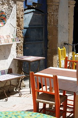 essaouira tables (kexi) Tags: africa orange colors yellow vertical canon march cafe chairs empty morocco maroc tables essaouira 2015 maroko instantfave