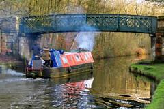 narrow boat (togwood) Tags: bridge trees winter reflections smoke ripples narrowboat canalboat wigan leedsliverpoolcanal canalbarge explored picasaortonish