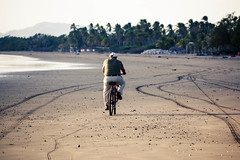 A sunday ride (minorninth9) Tags: travel beach sand cyclist tracks tropical nicaragua jiquilillo