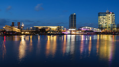Electric Blue (McQuaide Photography) Tags: city blue winter light urban holland reflection water netherlands dutch amsterdam skyline architecture zeiss photoshop outside licht twilight lowlight europe waterfront outdoor dusk widescreen sony tripod capital nederland panoramic illuminated adobe bluehour fullframe alpha 169 modernarchitecture waterside stad manfrotto noordholland lightroom capitalcity 1635mm northholland a7ii dijksgracht variotessar mirrorless sonyzeiss upofficebuilding mcquaidephotography ilce7m2