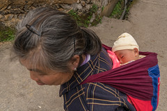 Grandmother and grandaughter.jpg (Photos4Health) Tags: china old travel sunset shadow woman guy ecology female sunrise dark person li asia village child place guilin yangshuo hill chinese elderly fisher stick tradition guizhou villager guangxi ecotourism xingping