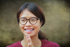 an enchanting smile (ulli_p) Tags: light people woman art texture girl smile portraits thailand asia southeastasia faces head textured isan aworkofart flickraward texturedphoto ruralthailand unseenasia platinumheartaward earthasia totallythailand artofimages canoneoskissx5