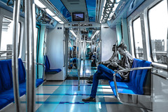Urban Blue (relishedmonkey) Tags: lighting street blue light people colour lines train 35mm reflections person design nikon dubai floor dynamic legs metro steel uae shapes indoor jeans seats range selective 18g d5300