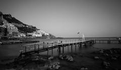 Amalfi, Amalfi Coast, Italy (twinsfan7777) Tags: ocean longexposure sea blackandwhite water monochrome coast town dock amalficoast positano amalfi praiano tokina1224mmf4 canoneosrebelt2i canoneosrebel550d