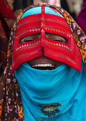 a laughing bandari woman wearing a traditional mask called the burqa at panjshambe bazar thursday market, Hormozgan, Minab, Iran (Eric Lafforgue) Tags: red people woman face vertical laughing outdoors persian clothing asia veil dress mask iran muslim islam religion hijab culture persia headshot hidden identity human covered iranian bazaar tribe adults adultsonly cultural oneperson traditionaldress burqa customs middleeastern sunni burka chador balouch hormozgan onewomanonly burqua  bandari  1people  iro thursdaymarket  minab unrecognizableperson colourpicture  borqe panjshambe boregheh iran034i2771