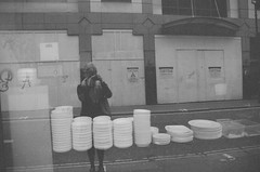 plates (maggyvaneijk) Tags: blackandwhite bw selfportrait reflection london film monochrome 35mm grain chinese plates shopwindow oxfordcircus