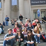 Students posing outside of a museum.
