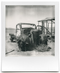 the last mile. white pine, nv. 2015. by eyetwist - polaroid week 2016. a rusty truck somewhere along US 93 in eastern nevada.  vintage polaroid SX-70 camera electronically modified to shoot 600 series film, impossible project B&W generation 2.0 beta test film. scan: epson V750. exif tags: filmtagger.