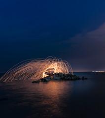 Fire Dance Ritual (YOSHIKA |  | 4) Tags: ocean longexposure sea sky test beach water rock clouds stars fire starry qatar corel dukhan
