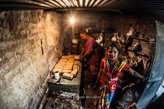 Husband and wife  preparing bread in traditional style. Location : Pushkar village, Pushkar, India. (Nor Hidayat Hj.Mohamed) Tags: travel india bread nikon asia handmade traditional fisheye hut wives pushkar journalism husbands handhelds d700