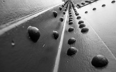 Riveting (DobingDesign) Tags: sanfrancisco california bridge blackandwhite abstract texture lines metal us unitedstates angle architecturaldetail steel perspective stripe goldengatebridge round straight whitestripe studs brushstrokes abstractarchitecture