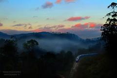 Railway Morning (Manuj Kavindra) Tags: morning blue red mountains cold clouds train sunrise landscape nikon railway adventure bigsky silhoutte nikond3100 birrdseye