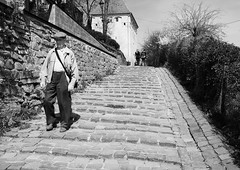 Sighisoara, Romania (PM Kelly) Tags: street old travel blackandwhite bw man black blackwhite day alone walk romania sighisoara transylvania bnw