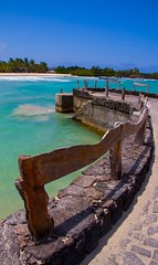 Just around the bend lies paradise (Spencer Cooke) Tags: wood southamerica nature water beautiful stone port canon outdoors ecuador dock sand paradise gorgeous relaxing peaceful depthoffield tropical serene galapagosislands isabelaisland spencerthecookephotography