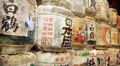 Gods Just Want to Have Fun (Seeing Visions) Tags: texture phoenix japan temple crane text straw rope sake kanji jp offering tied nara 2009 logos stacked casks kasugataisha daikokuten raymondfujioka