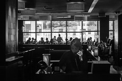 Reservations (John St John Photography) Tags: nyc newyorkcity windows blackandwhite bw newyork silhouette restaurant perspective streetphotography dining columbuscircle receptiondesk diners timewarnercenter candidphotography reservations