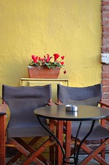 (konstantina ant.) Tags: life red flower beautiful beauty yellow table colours chairs greece thessaloniki ladadika