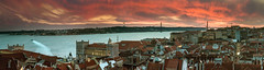 Lisbon red (Pietro Faccioli) Tags: city bridge houses windows winter sunset red sky urban panorama cloud sun portugal water night clouds buildings river lights evening boat town twilight downtown afternoon view sundown terrace lisbon panoramic roofs belvedere tejo oldtown miradouro tagus pietro cristorei faccioli pietrofaccioli