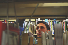Looking (alexiscooperphotography) Tags: portrait college composition photography book photo looking library collegelife intresting collegeboy creativephotography nikond3100 lookingthroughlens
