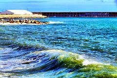 Seagulls and wave (explored 2016/02/18) (Fnikos) Tags: light sea sky seascape water stone skyline architecture port puerto agua waterfront outdoor seagull wave sidewalk cielo