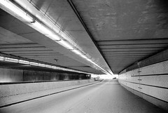 A Tunnel (Simone Della Fornace) Tags: street leica city urban blackandwhite white black holland film lines architecture analog underground utrecht empty voigtlander nederland streetphotography tunnel streetphoto passage bianco ilford nero biancoenero