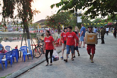 We are family (Roving I) Tags: family friends tourism tourists vietnam hoian boxes riverfront matching tshirts loads slogans carrying