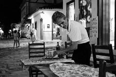 Retirando a mesa (renanluna) Tags: blackandwhite bw man riodejaneiro paraty night table fuji br rj monochromatic pb noite fujifilm 55 homem pretoebranco monocromia mesa x100 021 renanluna fujifilmfinepixx100