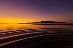 Rangituhi Channel, twilight zone (bob_katt) Tags: sunset sea newzealand sky moon beach water silhouette canon coast natural ripple wave northisland wonders kapiti paraparaumu eos500d rangituhi