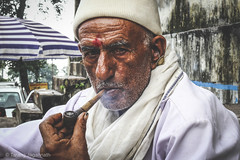I know my worth, I'm priceless. (Tarang Jagannath) Tags: old portrait man color smoking hukka