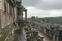 Angkor Wat in the rain (tmeallen) Tags: temple cambodia gallery rainyday buddhist courtyard angkorwat jungle siemreap hindu 12thcentury malefigure khmerempire shelteringfromrain centertemple
