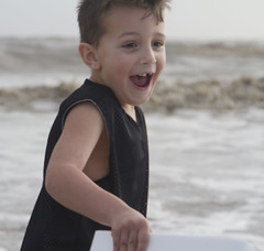 The Beach in Winter (Trudy -) Tags: boy male beach gulfofmexico water smile fun outdoors joy trudyledoux